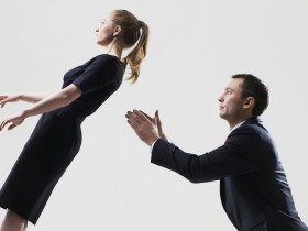 Businessman catching businesswoman
