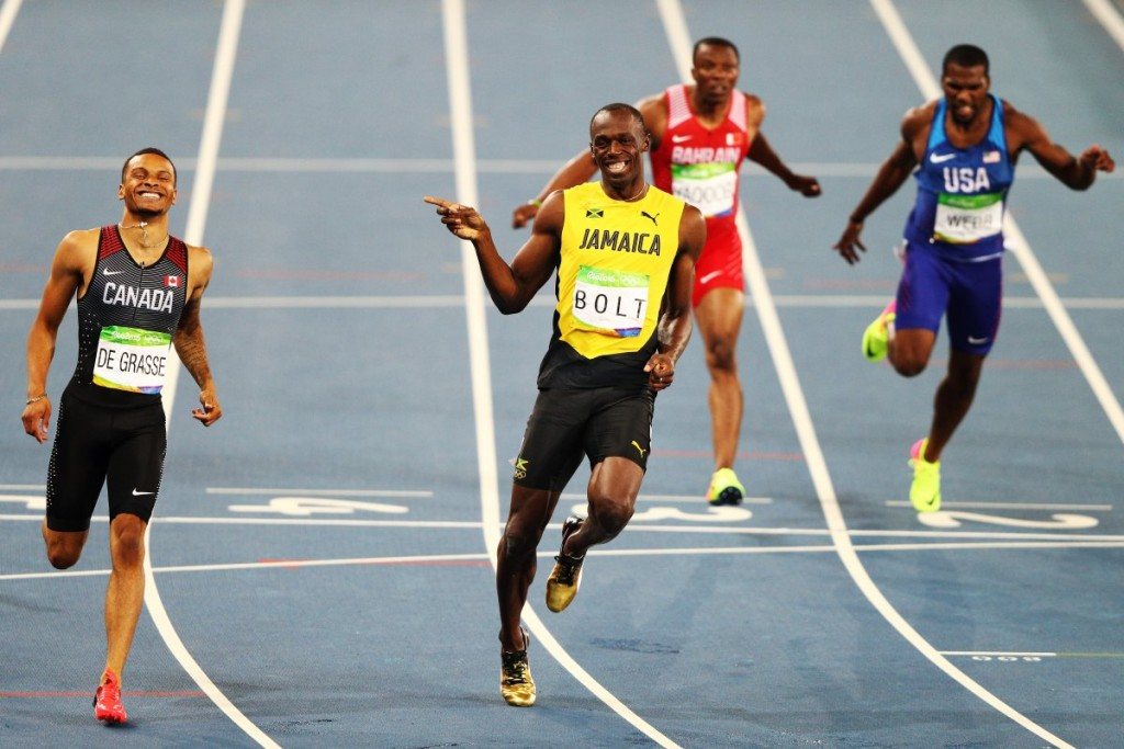 jamaicas-usain-bolt-and-his-canadian-rival-andre-de-grasse-were-so-far-ahead-of-the-competition-during-the-200-meter-semifinal-they-couldnt-help-but-share-a-laugh