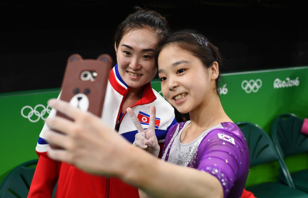 one-of-the-most-iconic-images-from-the-rio-games-is-of-north-korean-gymnast-hong-un-jong-taking-a-selfie-with-lee-eun-ju-of-south-korea-citizens-of-the-two-countries-rarely-make-contact-with-one-another