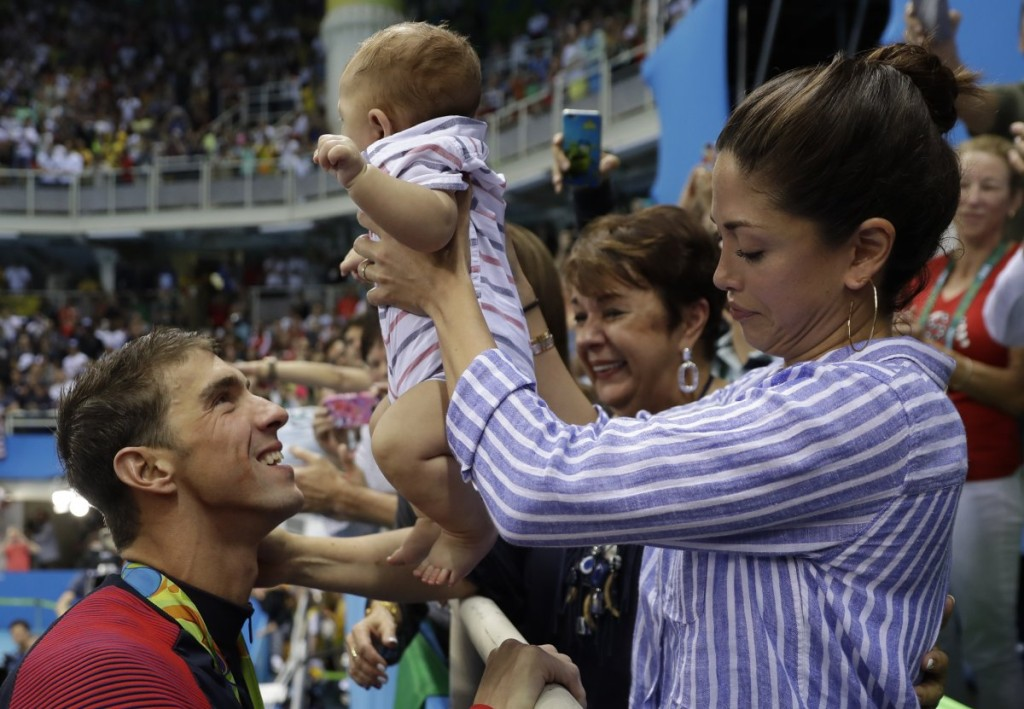us-swimmer-michael-phelps-may-be-the-greatest-olympian-of-all-time-but-hes-also-a-doting-new-father-here-he-is-greeting-his-son-boomer-after-winning-yet-another-medal